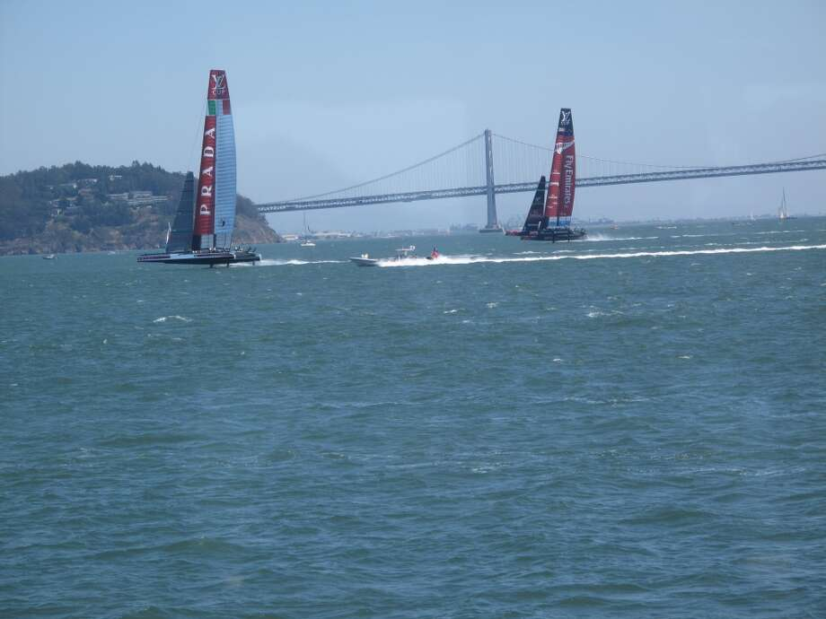From VIP boat, Aug. 21, 2013; Rounding a marker, Emirates in the lead. Bay Bridge getting ready for its own dramatic closing re-opening. Photo: Leah Garchik