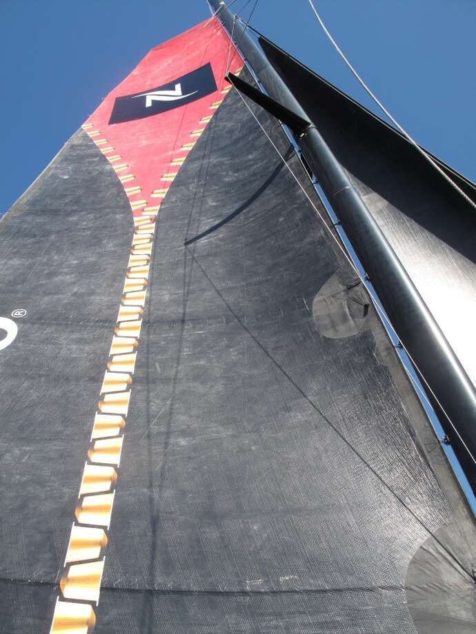On the catamaran, Aug. 21, 2013; Looking up at the sail, cloth rather than the rigid ones that are on the serious racing  catamarans Photo: Leah Garchik