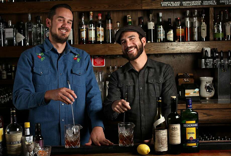 Bar manager Lucien Sankey (left) and General Manager Dan Stahl (right) make cocktails at Rickhouse in San Francisco, Calif.,  on Tuesday, August 13, 2013. Photo: Liz Hafalia, The Chronicle