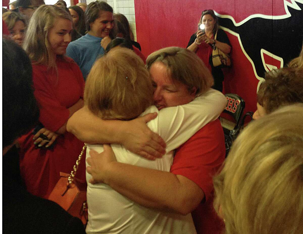 Tina Young hugs Spring Branch Athletic Department employee Martha Schwartz on Monday, Aug. 5 after delivering an announcement to the community about her stage 4 lung cancer.