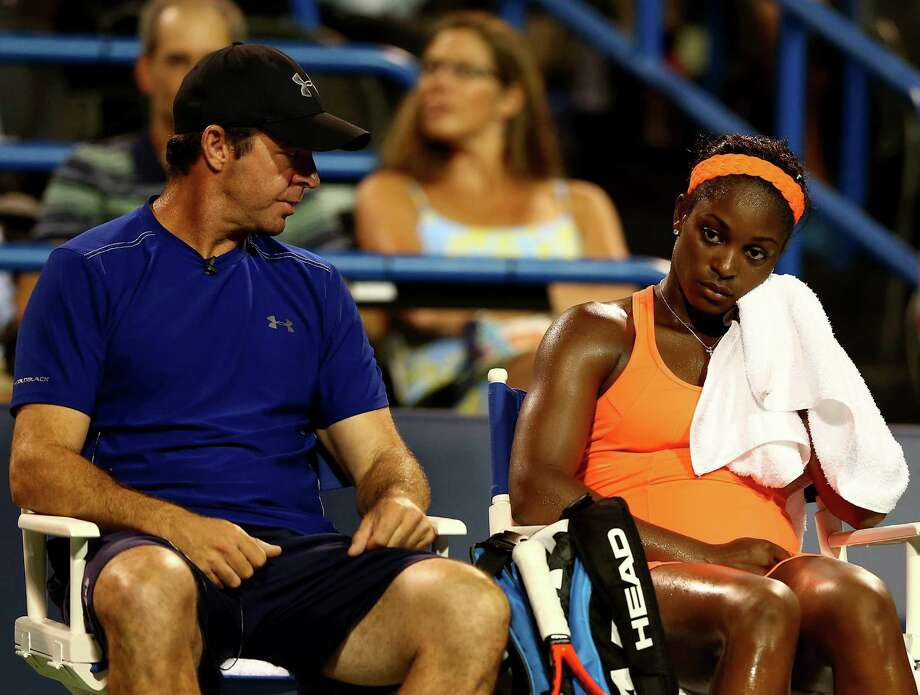 NEW HAVEN, CT - AUGUST 22:  Sloane Stephens of the USA talks with her coach, David Nainkin, after she lost the first set to Caroline Wozniacki of Denmark during Day Five of the New Haven Open at Connecticut Tennis Center at Yale on August 22, 2013 in New Haven, Connecticut. Photo: Elsa, Getty Images / 2013 Getty Images