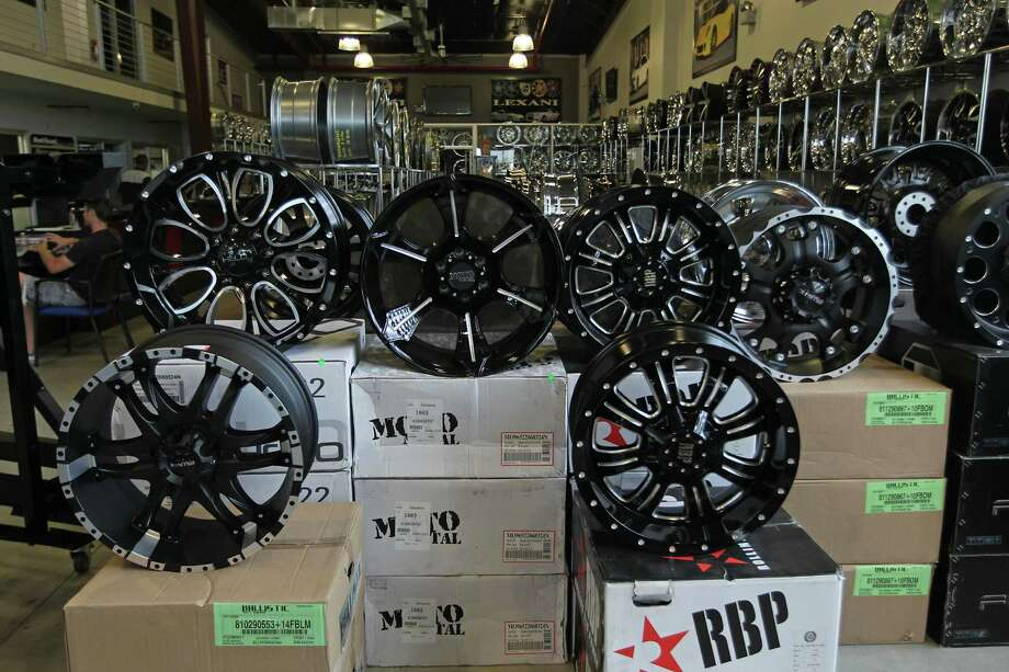 """""""Wheels act as an instant upgrade, are easy to install and come in a lot of price points,"""" says a manufacturing trade group executive of the array of options available, with black in vogue these days. Photo: Photos By James Nielsen / Houston Chronicle"""
