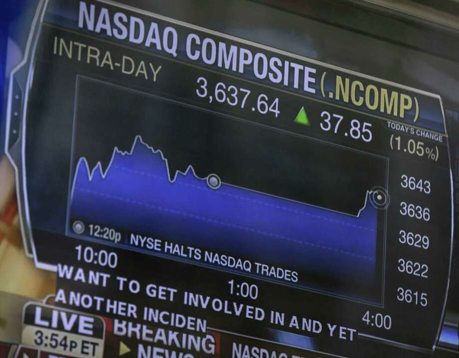 A television displays news about Nasdaq trading in New York. The Nasdaq halted trading because of a technical problem, the latest glitch to affect the stock market. Photo: Seth Wenig / Associated Press