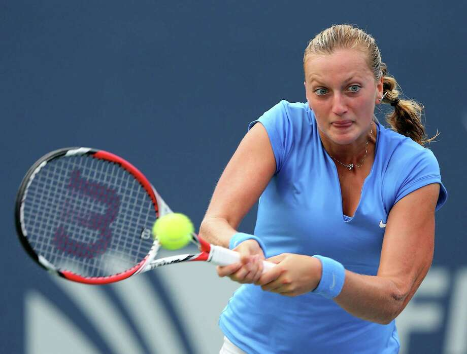 NEW HAVEN, CT - AUGUST 22:  Petra Kvitova of the Czech Republic returns a shot to Anastasia Pavlyuchenkova of Russia during Day Five of the New Haven Open at Yale at the Connecticut Tennis Center on August 22, 2013 in New Haven, Connecticut. Photo: Elsa, Getty Images / 2013 Getty Images