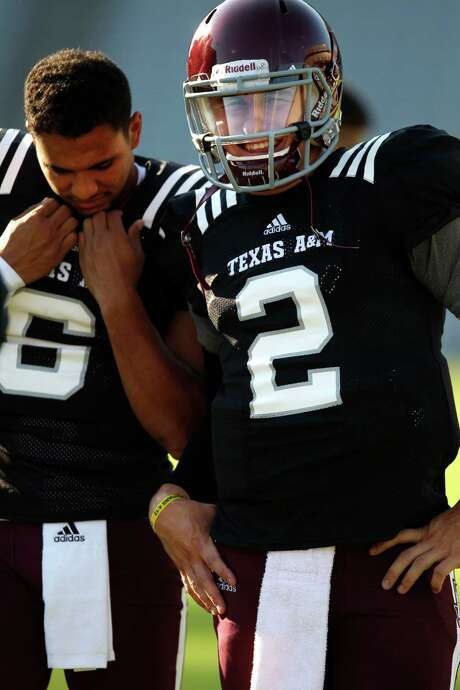Matt Davis, left, decided to transfer after losing ground in the contest to serve as Johnny Manziel's backup. Photo: Eric Christian Smith, Freelance