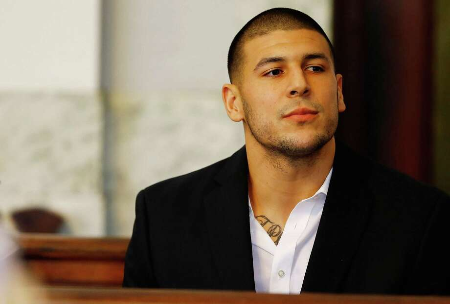 NORTH ATTLEBORO, MA - AUGUST 22: Aaron Hernandez sits in the courtroom of the Attleboro District Court during his hearing on August 22, 2013 in North Attleboro, Massachusetts. Former New England Patriot Aaron Hernandez has been indicted on a first-degree murder charge for the death of Odin Lloyd. (Photo by Jared Wickerham/Getty Images) Photo: Jared Wickerham, Staff / 2013 Getty Images