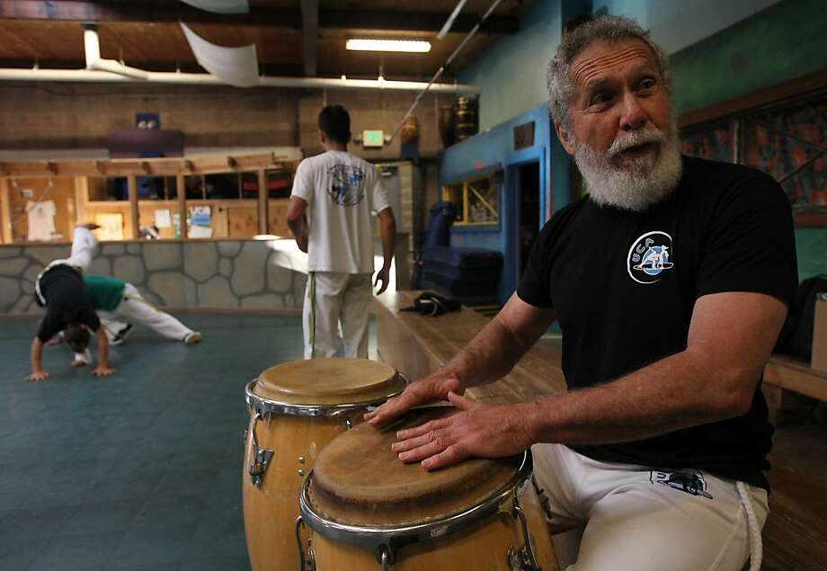 Mestre Acordeon drums for his students at Capoeira Arts Foundation in Berkeley, Calif. on Wednesday, August 21, 2013. Almeida and some of his students are riding bicycles from Berkeley to Brazil to raise money a charity for Brazilian children. Photo: Mathew Sumner, Special To The Chronicle