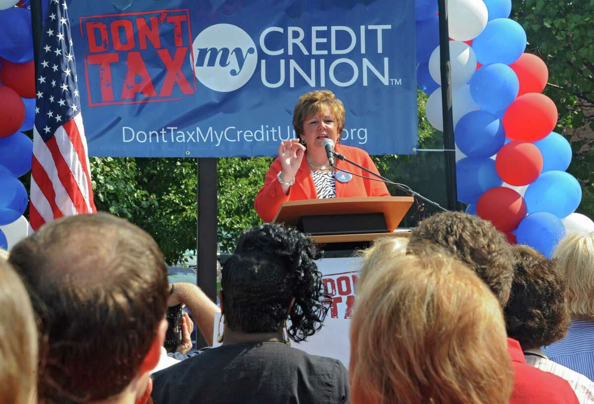 Paula Stopera, president and CEO of CAP COM FCU, speaks as members and leaders of local credit unions and Credit Union Association of New York rally outside of the Credit Union Association of NY on Thursday, Aug. 22, 2013 in Colonie, N.Y. The members were demonstrating the urgency of having everyone understand how the banking industry's campaign to tax credit unions is a bad idea. (Lori Van Buren / Times Union)