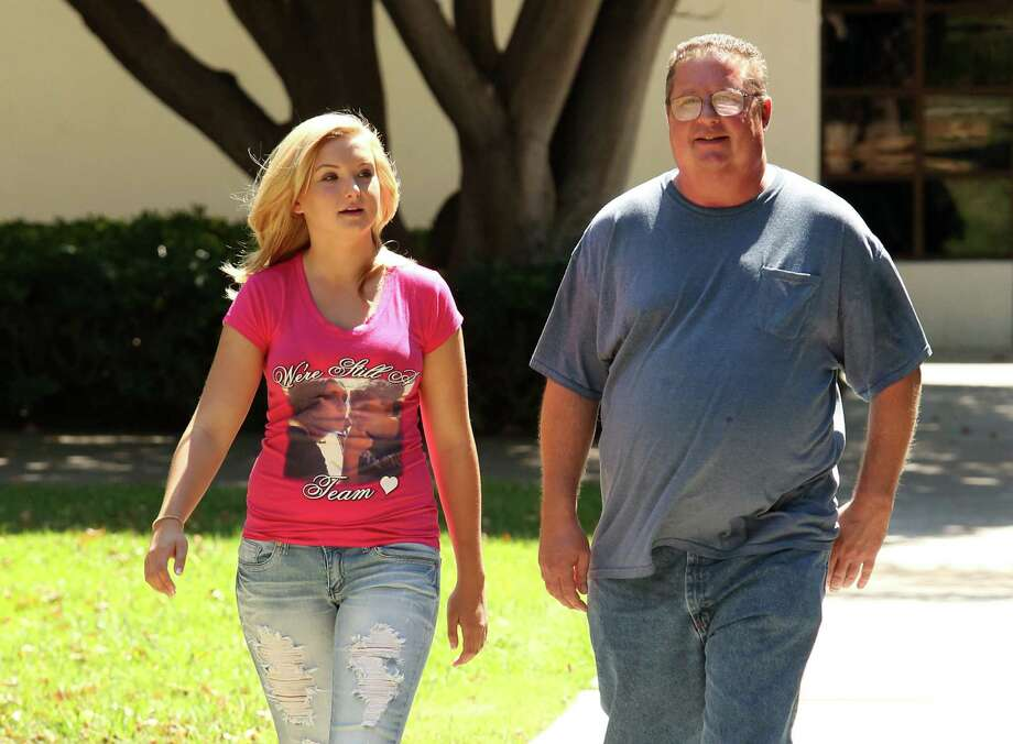 Hannah Anderson and her father, Brett Anderson, in San Diego, Calif. Hannah's mother and brother were killed by family friend James Lee DiMaggio. Authorities killed him on Aug. 10. Photo: Jesse Grant / NBC / Associated Press