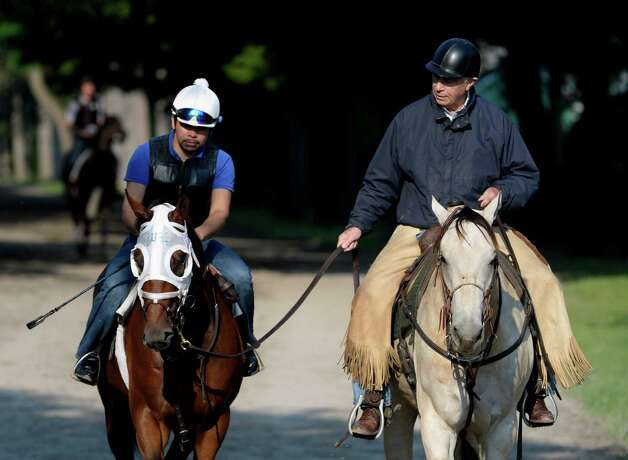 Trainer D. Wayne Lukas leads one of his charges from the Oklahoma Training track Thursday Aug. 22, 2013, at Saratoga Race Course in Saratoga Springs, N.Y.  (Skip Dickstein/Times Union) Photo: SKIP DICKSTEIN