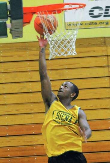 Evan Hymes goes up for a layup as the Siena men's basketball team practices in preparation for a tri