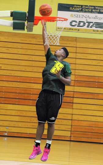 Javion Ogunyemi of Troy goes up for a layup as the Siena men's basketball team practices in preparat