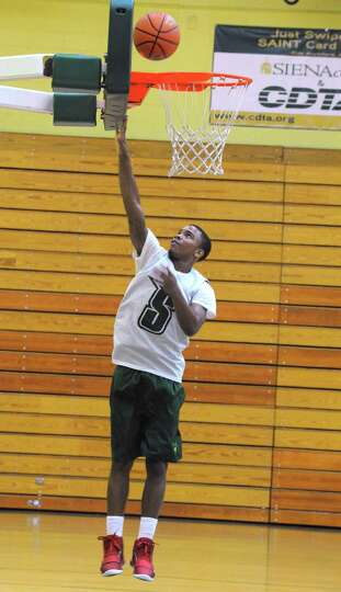 Marquis Wright goes up for a basket as the Siena men's basketball team practices in preparation for