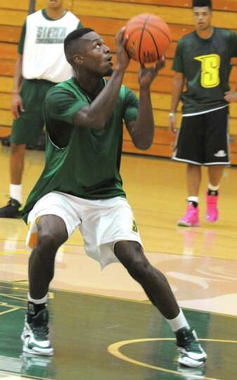 Maurice White eyes the basket as the Siena men's basketball team practices in preparation for a trip