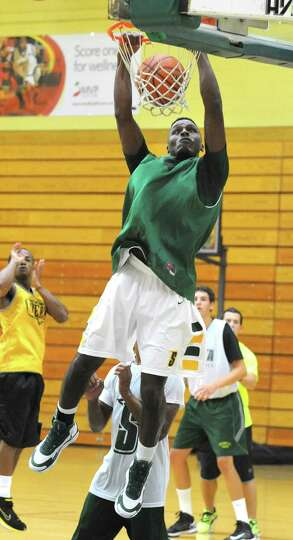 Maurice White slam dunks the ball as the Siena men's basketball team practices in preparation for a