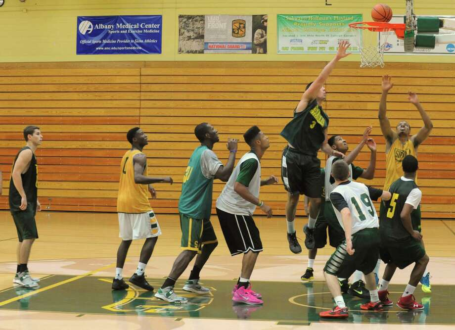 The Siena men's basketball team practices in preparation for a trip to Montreal Tuesday, Aug. 20, 2013 in Loudonville, N.Y. They will be playing a series of games against Canadian teams. (Lori Van Buren / Times Union) Photo: Lori Van Buren / 00023580A