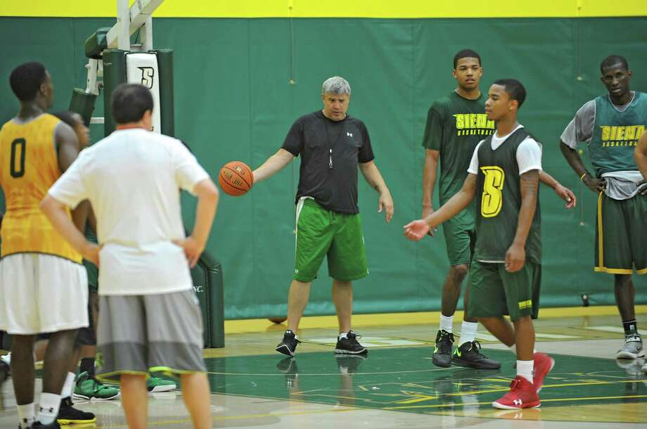 Head coach Jimmy Patsos, center, talks to his players as the Siena men's basketball team practices in preparation for a trip to Montreal Tuesday, Aug. 20, 2013 in Loudonville, N.Y. They will be playing a series of games against Canadian teams. (Lori Van Buren / Times Union) Photo: Lori Van Buren / 00023580A
