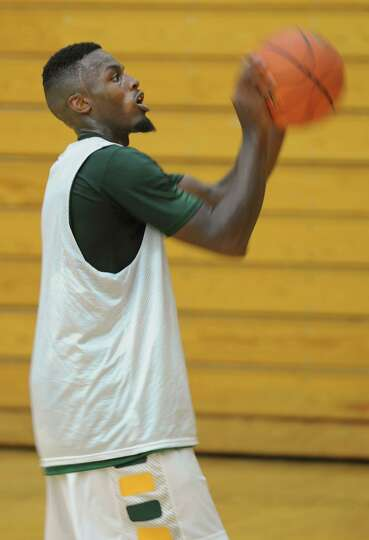 Maurice White works on his free throw shot as the Siena men's basketball team practices in preparati