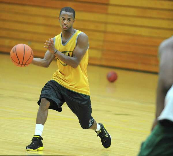 Evan Hymes passes the ball as the Siena men's basketball team practices in preparation for a trip to