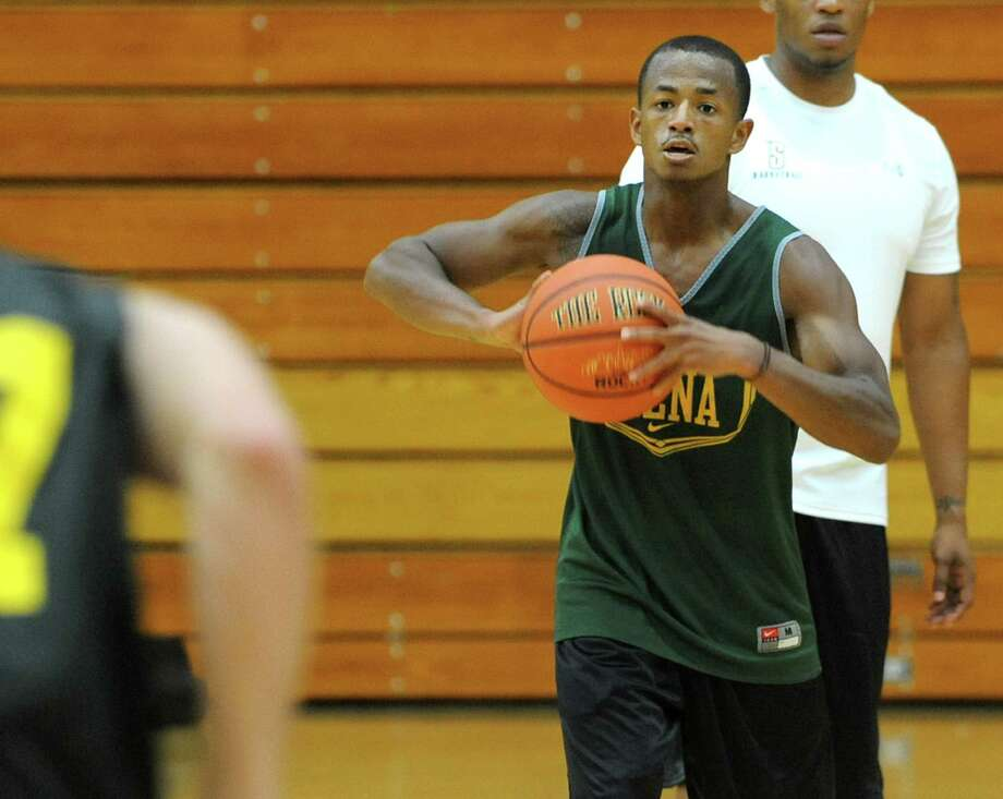 Evan Hymes passes the ball as the Siena men's basketball team practices in preparation for a trip to Montreal Tuesday, Aug. 20, 2013 in Loudonville, N.Y. They will be playing a series of games against Canadian teams. (Lori Van Buren / Times Union) Photo: Lori Van Buren / 00023580A