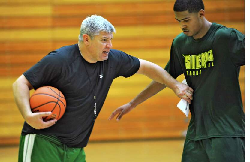 Head coach Jimmy Patsos explains something using Mike Wolfe as the Siena men's basketball team pract