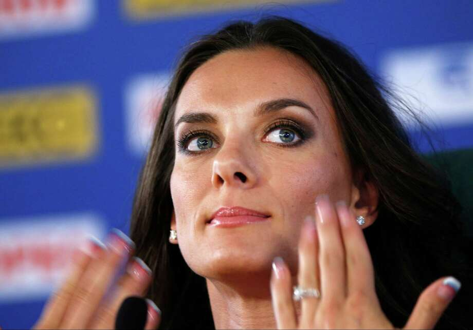 Russia's Yelena Isinbayeva, the gold medalist in the women's pole vault,  gestures during a press conference at the World Athletics Championships in the Luzhniki stadium in Moscow, Russia, Thursday, Aug. 15, 2013.   (AP Photo/Alexander Zemlianichenko) ORG XMIT: WTF806 Photo: Alexander Zemlianichenko / AP