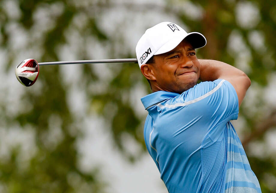 Tiger Woods endured two rain delays en route to a 67 Thursday at The Barclays at Liberty National. Photo: Darren Carroll / Getty Images