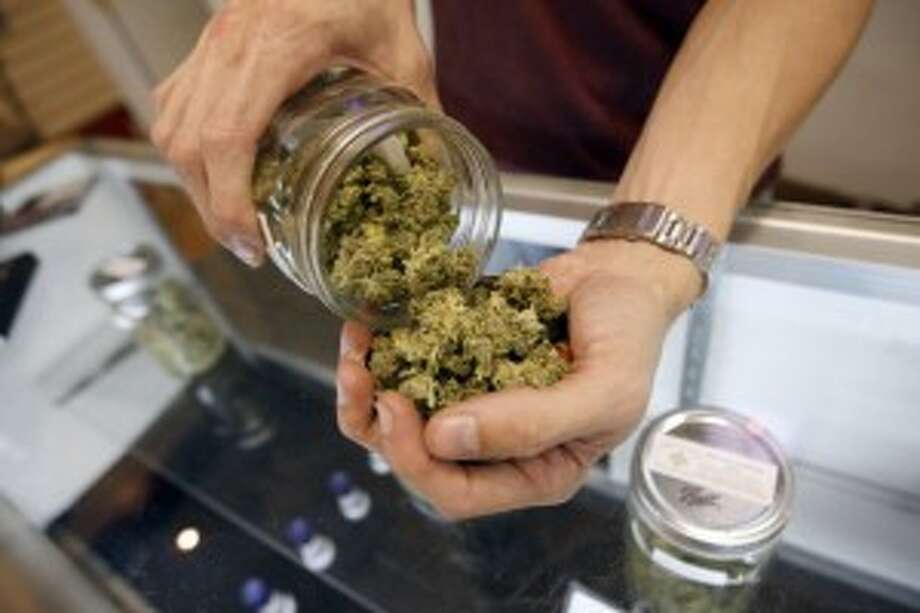 A cash-only transaction, or should marijuana businesses have access to banks and credit unions? (Getty Images)