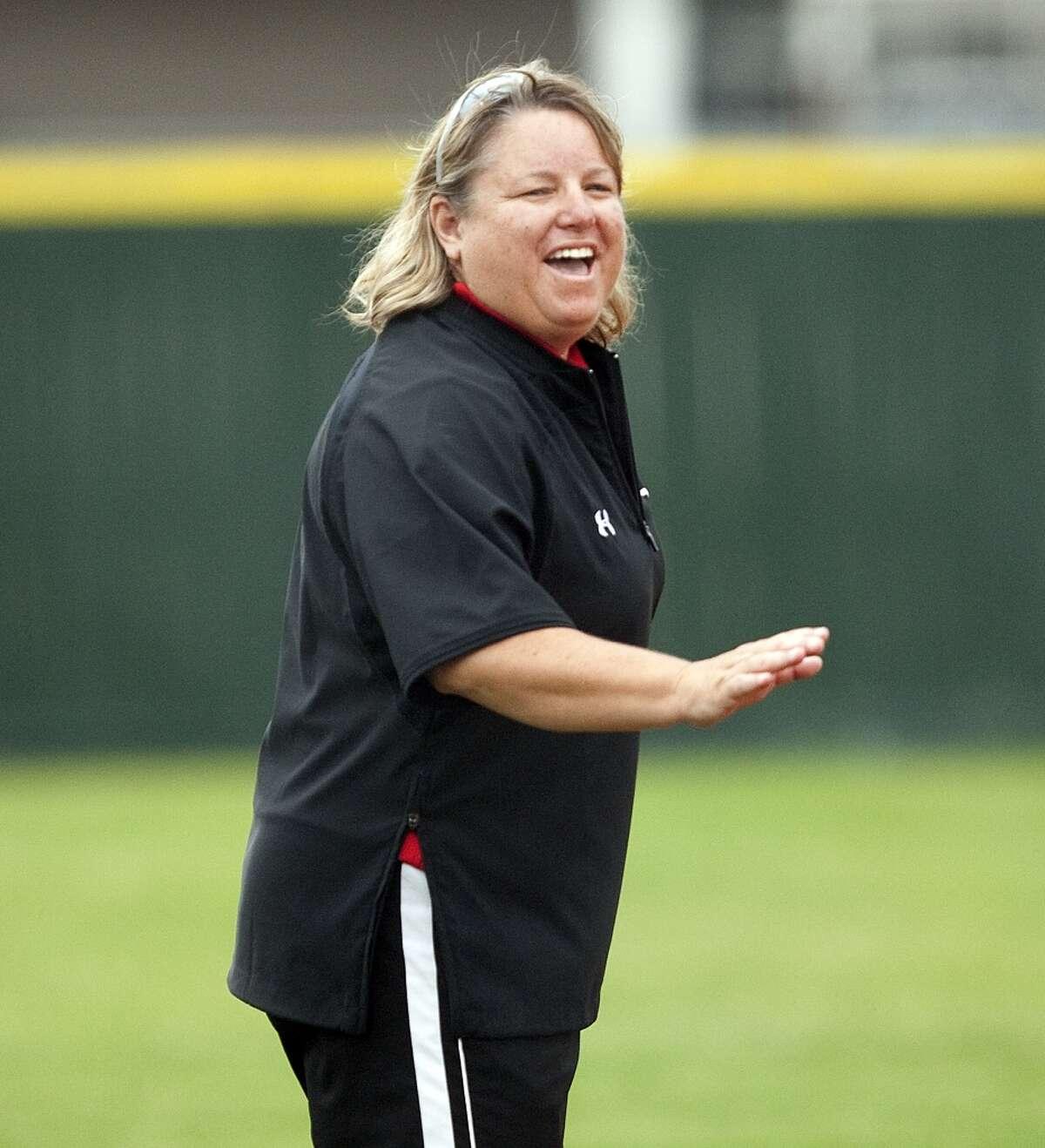 Memorial softball coach Tina Young laughs prior to a April 27, 2009 game.