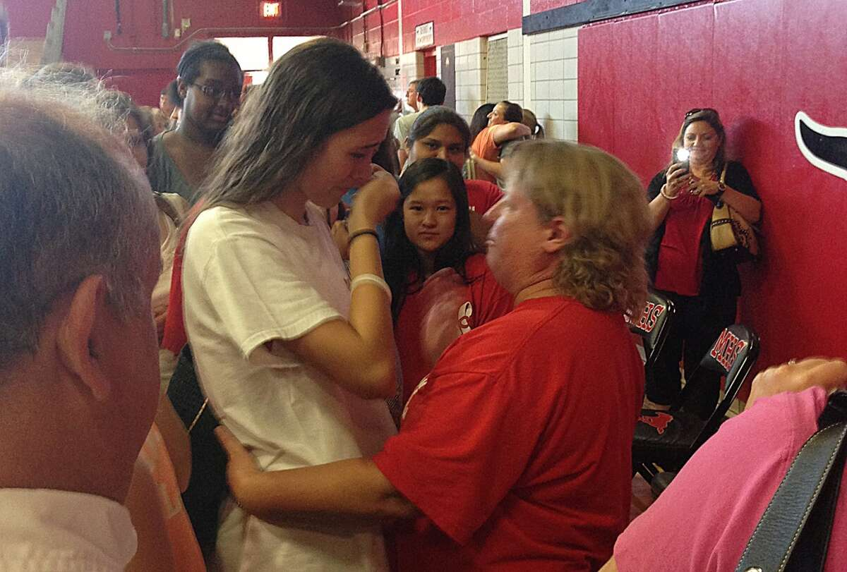 Tina Young comforts Memorial student Noemie Certson after Young made an announcement to the community about her Stage 4 lung cancer on Aug. 5.