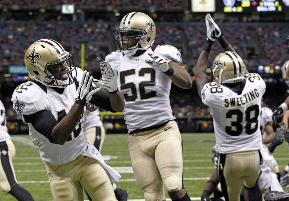20. New Orleans Saints  A solid color scheme and a classic logo, but the Saints can't seem to get the combination consistently right. Photo: Jonathan Bachman, Associated Press