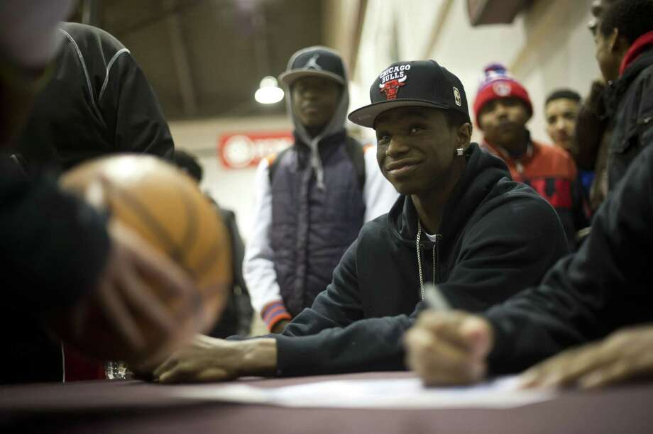 Items bearing the autograph of Kansas freshman basketball prospect Andrew Wiggins already are widely available on eBay. Photo: Lucas Oleniuk / Getty Images