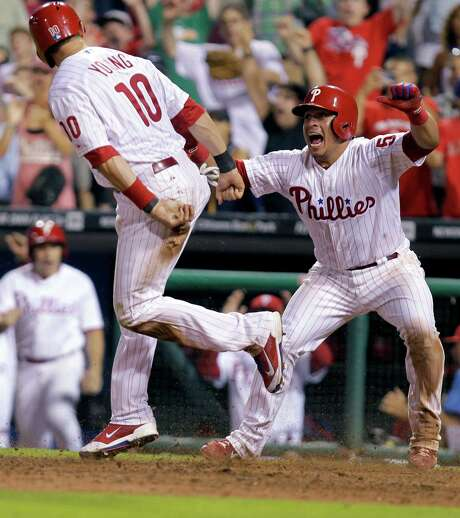 Despite their team being all but out of the playoff picture, Michael Young, left, and Carlos Ruiz had plenty to celebrate after the Phillies' walkoff win. Photo: Laurence Kesterson, FRE / FR170723 AP