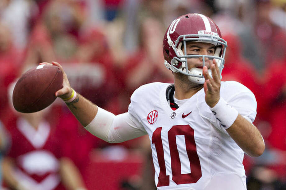 Alabama's A.J. McCarron has won two straight BCS titles but voted only preseason 3rd-team SEC.