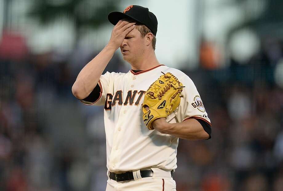SAN FRANCISCO, CA - AUGUST 22:  Matt Cain #18 of the San Francisco Giants wipes his face after giving up a second home run of the second inning, a solo shot to Jordy Mercer (not pictured) of the Pittsburgh Pirates at AT&T Park on August 22, 2013 in San Francisco, California. Two batters earlier, Cain gave up a solo shot to Garrett Jones.  (Photo by Thearon W. Henderson/Getty Images) Photo: Thearon W. Henderson, Getty Images