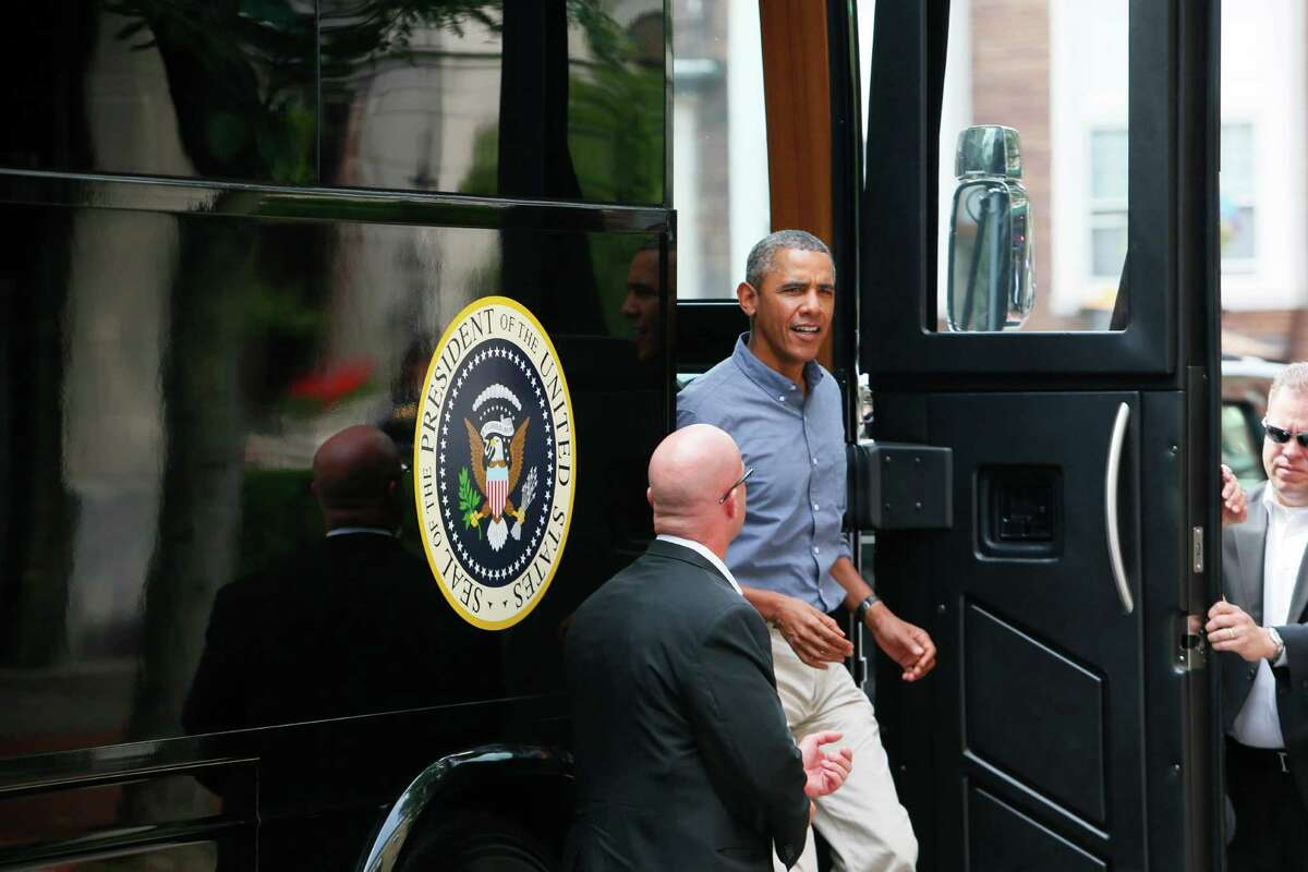 President Barack Obama steps off his bus during an unscheduled stop at Magnolia's Deli and Cafe in Rochester, N.Y., during his New York bus tour, Thursday, Aug. 22, 2013.