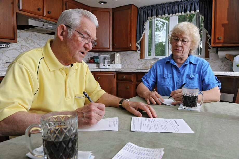 Anthony and Betty Zuelsdorf do the Super Quiz at their kitchen table on Wednesday, July 31, 2013 in Colonie, N.Y.  (Lori Van Buren / Times Union) Photo: Lori Van Buren / 00023325A