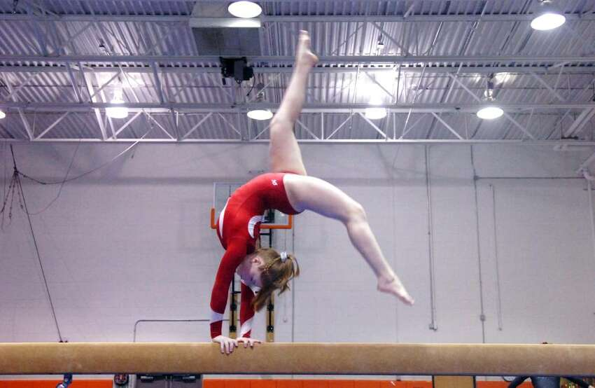 Greenwich's Becci Rieke on the balance beam as Greenwich High hosts Fairfield Warde and Ludlowe in a gumnastics match Thursday evening, January 21, 2010.