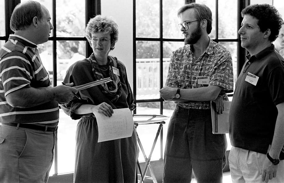 (from left) Ballmer, Irene Greif of Lotus/IBM Research, Ray Ozzie of Iris Associates/Microsoft and Jonathan Lazarus of Microsoft/Kiha Software talk at the PC Forum in 1989 in Palm Springs, Calif. Photo: Ann Yow-Dyson, Getty Images / Photo by Ann Yow-Dyson, all rights reserved