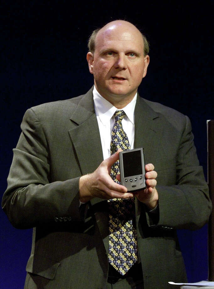 Microsoft President and CEO Steve Ballmer holds a new Pocket PC during a news conference April 19, 2000 in New York City's Grand Central Station. Ballmer announced the availability of the Pocket PC from hardware partners Casio, Compaq, Hewlett-Packard and Symbol Technologies. Photo: Jeff Christensen/RETIRED, Getty Images / Hulton Archive
