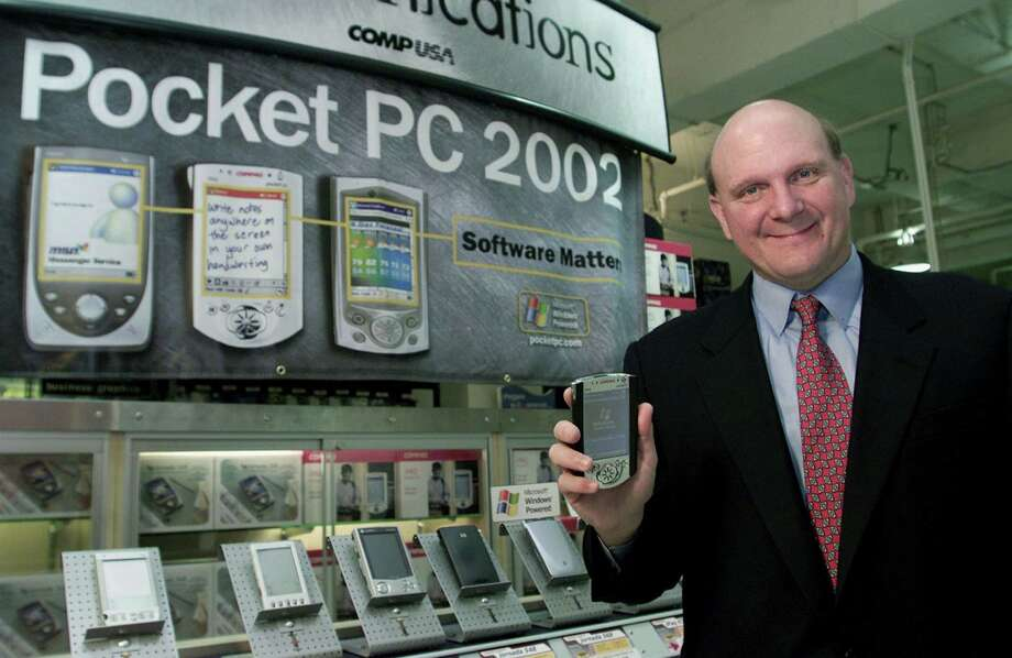 Ballmer holds a new Compaq pocket PC at the CompUSA store October 4, 2001 in San Francisco. Photo: Jeff Christensen, Getty Images / Getty Images North America