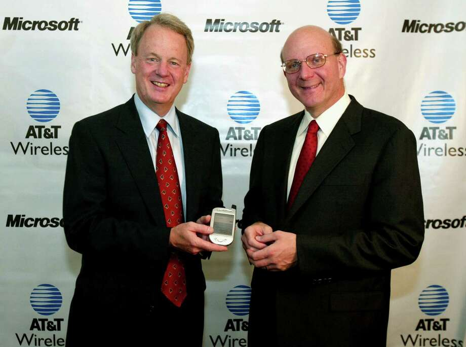 Ballmer and AT&T Wireless CEO John Zeglis announce an agreement on July 31, 2002 in New York to deliver wireless data and enabling technologies to customers across a range of devices such as Pocket PCs, Smartphones and laptops. Zeglis holds a new Pocket PC Phone. Photo: Jeff Christensen, WireImage / 2002 WireImage.com