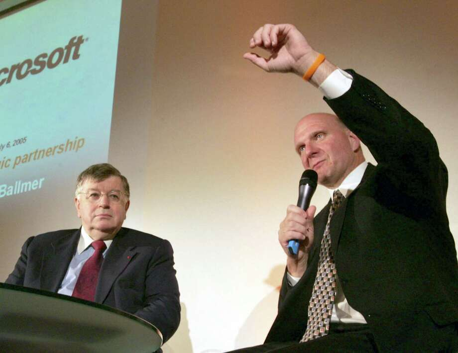 Balmer rocks a Livestrong bracelet as he discusses a partnership with France Telecom for joint development of multimedia products and services on July 6, 2005 in Paris. France Telecom CEO Didier Lombard looks on. Photo: MEHDI FEDOUACH, AFP/Getty Images / 2005 AFP