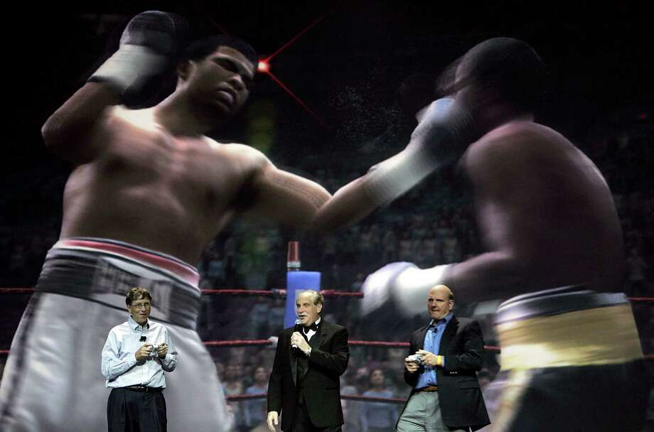 Balmer and Gates play the the XBOX game Fight Night Round 3 as boxing announcer Al Bernstein looks on during the opening keynote address at the 2006 Consumer Electronics Show January 4, 2006 in Las Vegas. Photo: Justin Sullivan, Getty Images / 2006 Getty Images