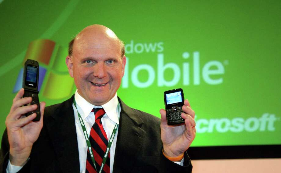 Ballmer holds the Samsung i-mate Smart Flip (left) and SGH-i320 during the 3GSM World Congress 2006 on February 14, 2006 in Barcelona. Photo: Handout, Getty Images / 2006 WCTV
