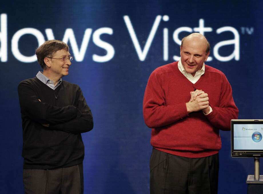 Gates looks on as Ballmer speaks during the launch of the disastrous Windows Vista operating system on January 29, 2007 in New York. Photo: TIMOTHY A. CLARY, AFP/Getty Images / 2007 AFP