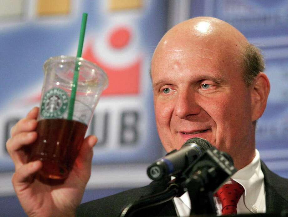 Ballmer holds up a Starbucks Coffee cup while delivering the keynote address to the Detroit Economic Club on June 15, 2007. Photo: Bill Pugliano, Getty Images / 2007 Getty Images