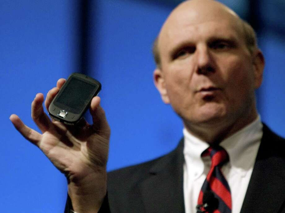 Ballmer holds up a Sprint Touch Windows Mobile phone by HTC during his keynote address at the CTIA WIRELESS I.T. & Entertainment 2007 conference on October 23, 2007 in San Francisco. Photo: Kimberly White, Getty Images / 2007 Getty Images