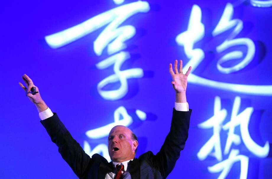 Ballmer gestures as he delivers his speech at the Great Hall of the People in Beijing, on November 7, 2007. Microsoft and Founder Technology Group, China's number two personal computer maker, signed an agreement to pre-install Microsoft's Windows operating system in PCs in a move to combat widespread Chinese product piracy. Photo: STR, AFP/Getty Images / 2007 AFP