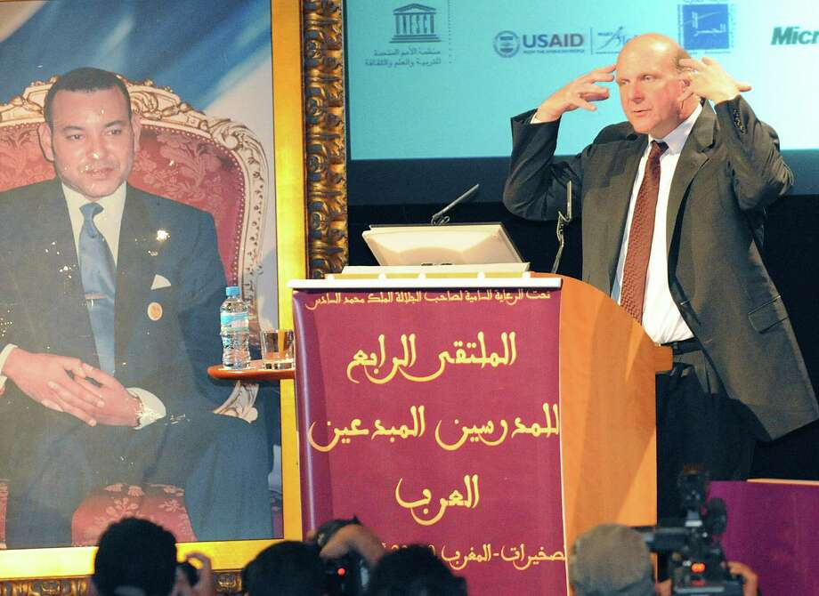 Ballmer speaks at the Arab Teachers Forum in Skhirat, near Rabat, Morocco, beside a portrait of Moroccan King Mohammed VI on April 22, 2008. Photo: ABDELHAK SENNA, AFP/Getty Images / 2008 AFP